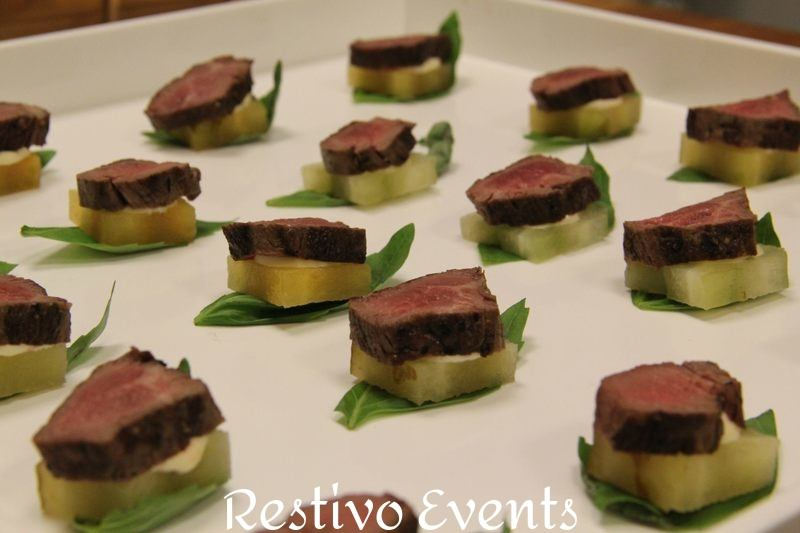 F27 - Sliced Pepper Crusted Beef Tenderloin on Crostini with Chipotle Sauce